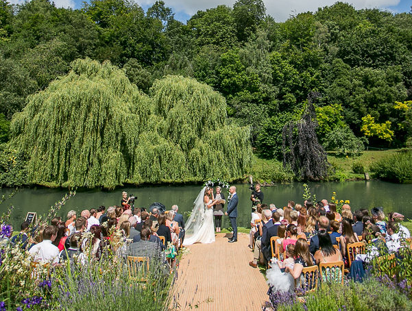 Celebrant of Surrey undertaking a bride and groom's lakeside ceremony in front of the Canal lake at Busbridge Lakes